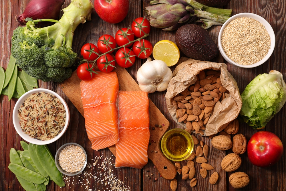 various foods like salmon, tomatoes, nuts, and vegetables for food allergy testing near me