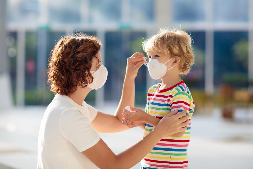 boy putting on mask to enter best pediatric allergist near me
