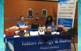 las vegas allergy doctor and nurses at table at health fair