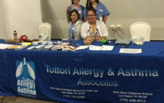 las vegas allergy doctor and nurses at booth at health fair