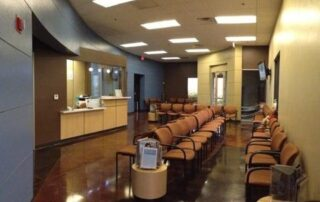 waiting room with lines of tan chairs at las vegas allergist
